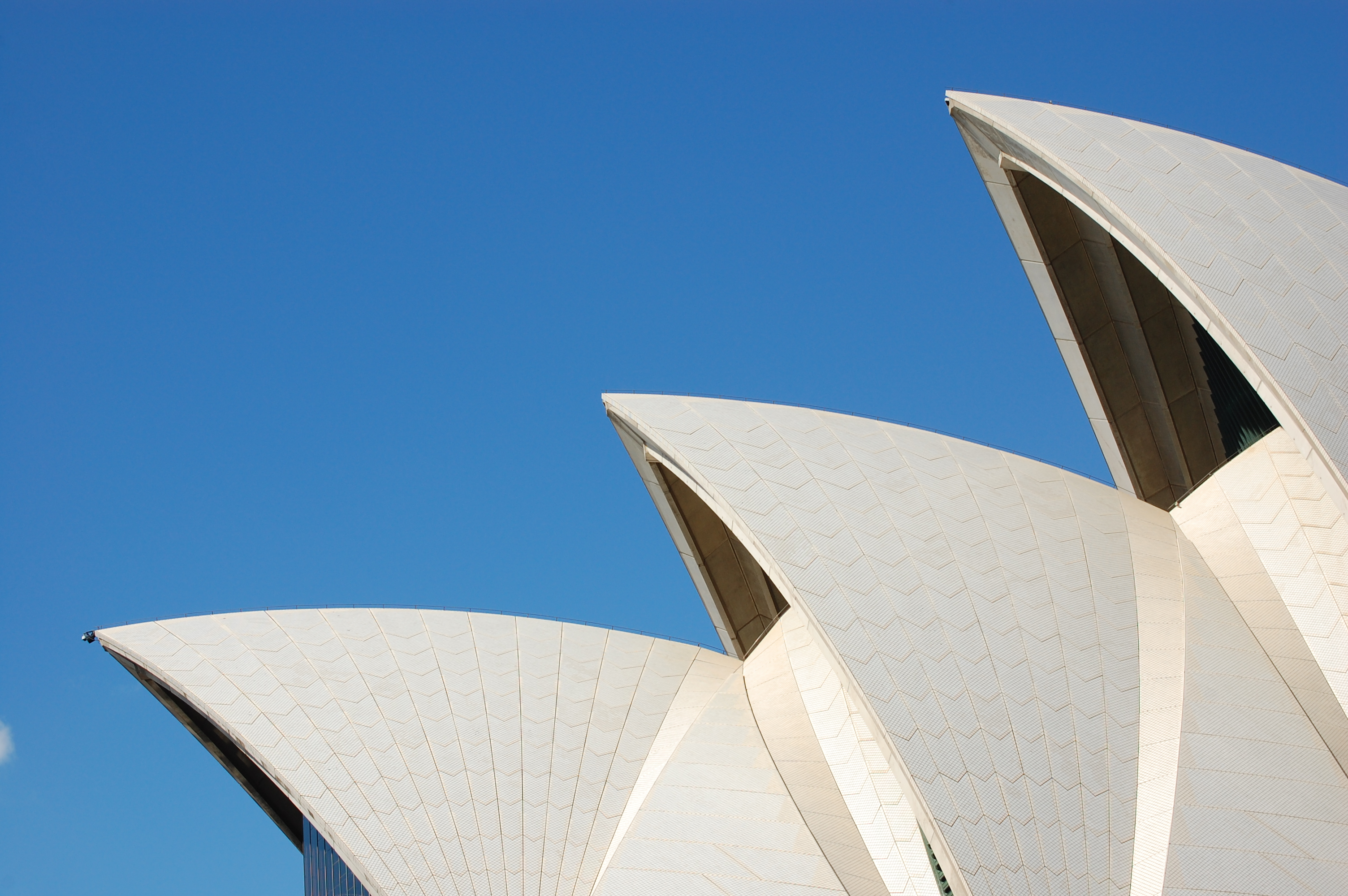 Sydney-Opera-House-Sails-Against-Blue-Sky-458111135_3008x2000