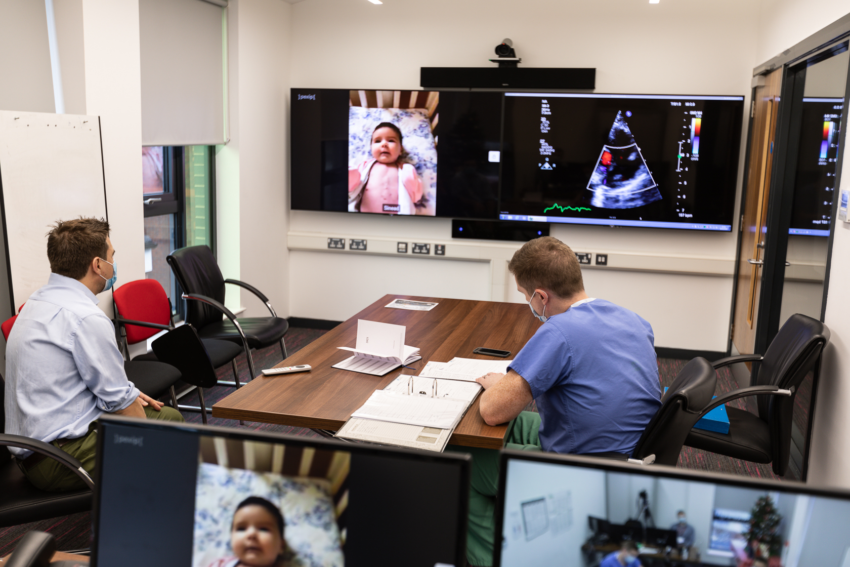 Medical staff perform remote telehealth video conference call via Pexip interoperability at Royal Belfast Hospital for Sick Children
