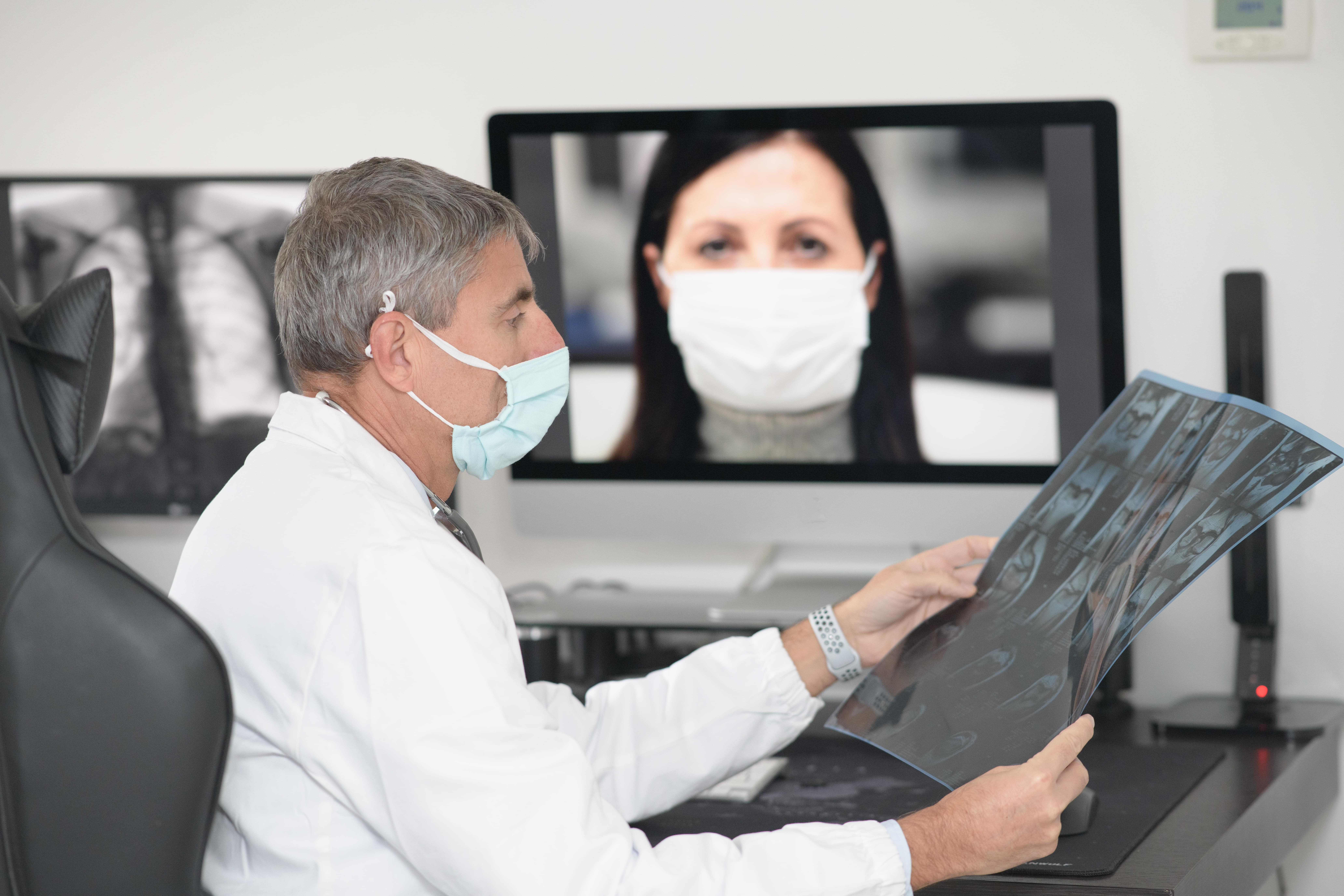 A doctor uses video conferencing for telehealth